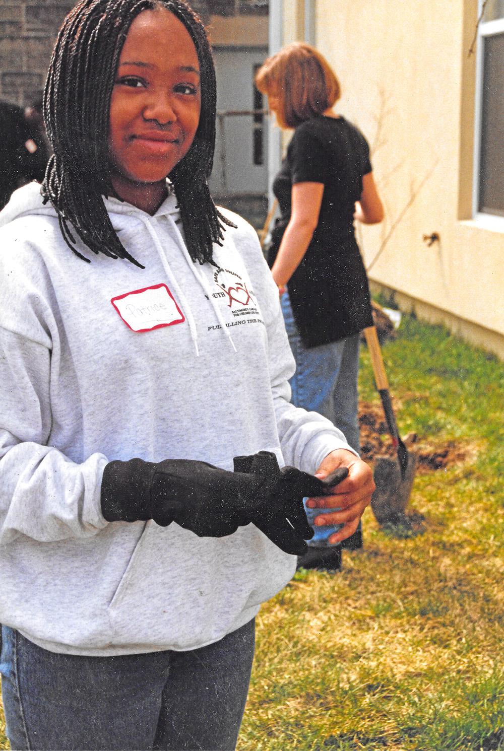 Patrice gets her garden gloves on. Photo by Cinder Hypki.